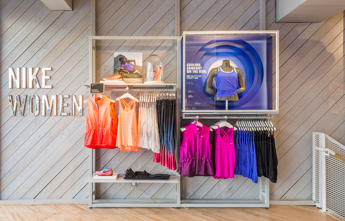 Aldworth James & Bond | Nike Women Store, London - CNC signage using mirrored acrylic