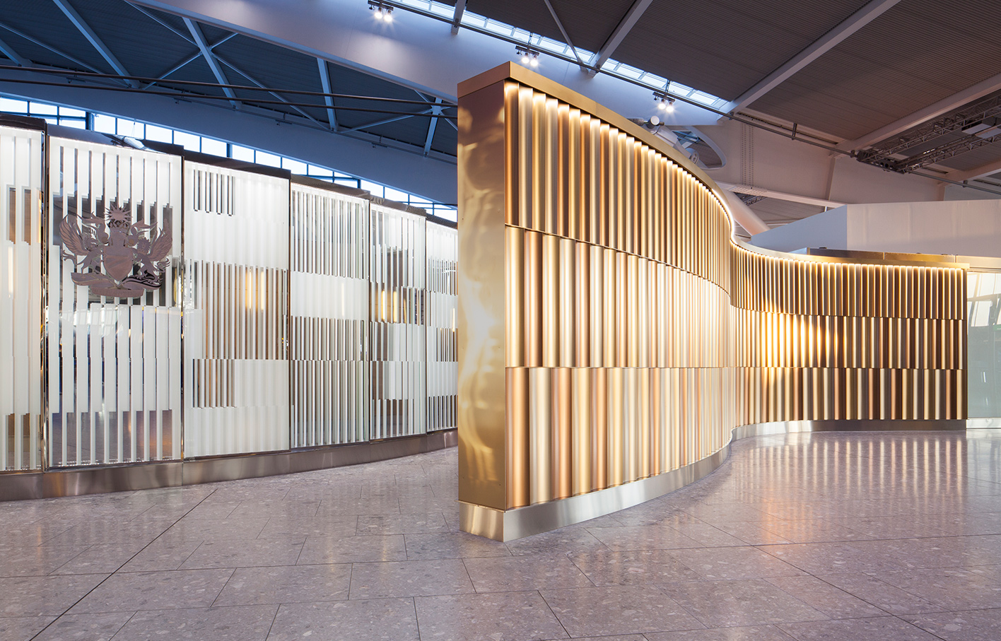 Aldworth James & Bond | Feature Walls - Heathrow T5 | Universal Design Studio | Mirrored wall and metal feature wall