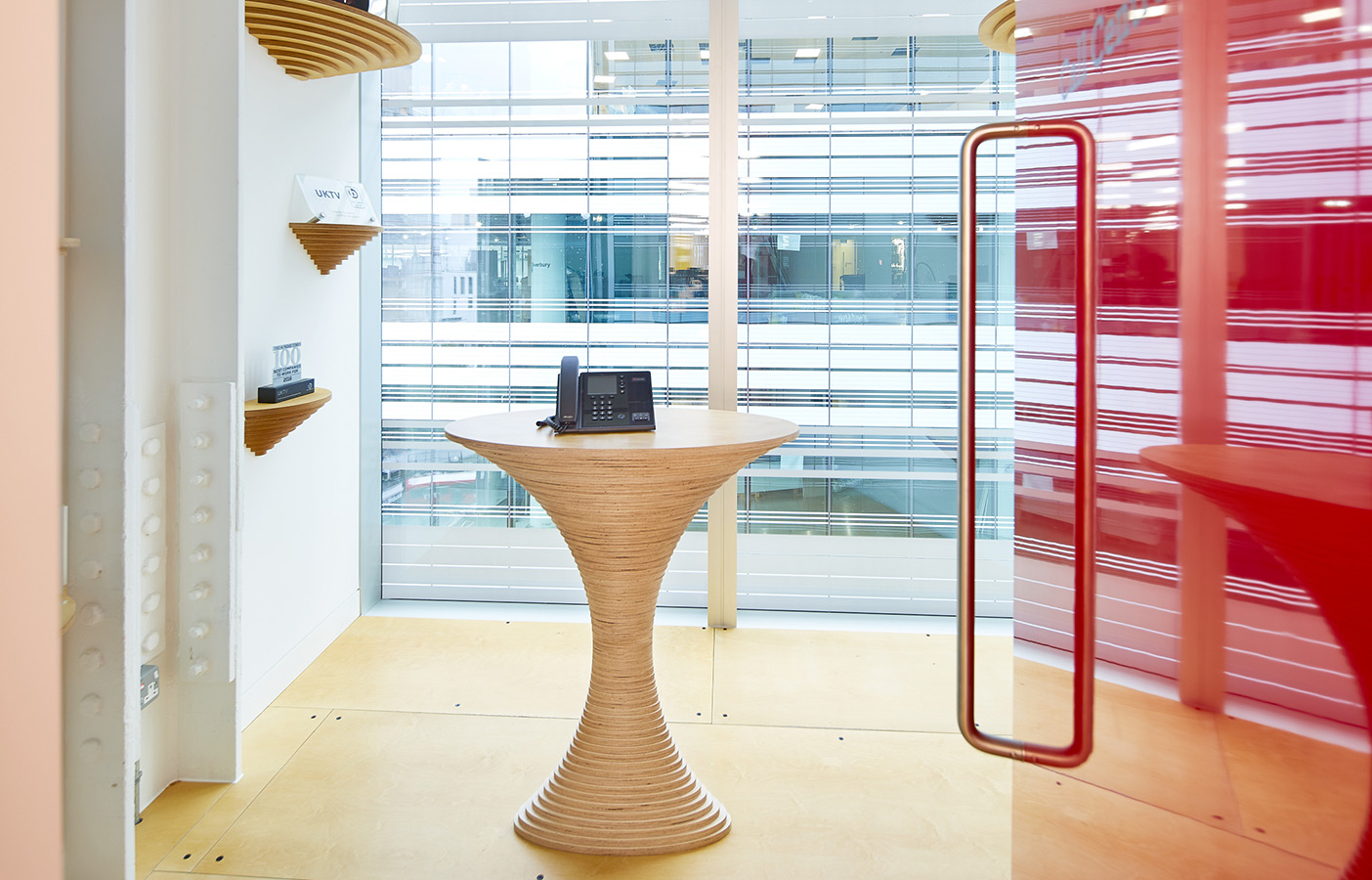 Aldworth James & Bond | UKTV Office Additions | Curved plywood phone stand
